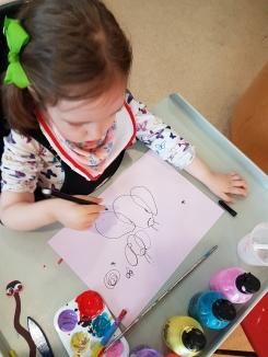Rosie drawing butterflies
